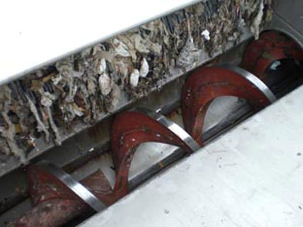 Guttridge centreless screw conveying household waste.